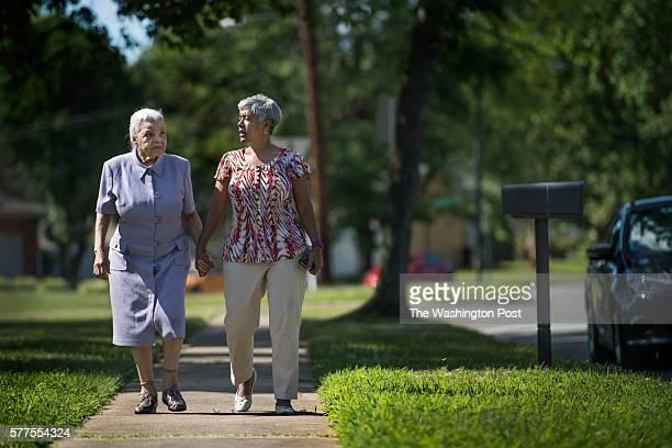Loretta Veney on a short walk with her mother Doris Woodward who has dementia in Ft Washington MD on June 29 2016 Loretta has an approach that is...