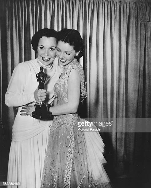Loretta Young congratulating actress Jane Wyman on her Best Actress Oscar for the film 'Johnny Belinda' at the 21st Academy Awards Los Angeles March...