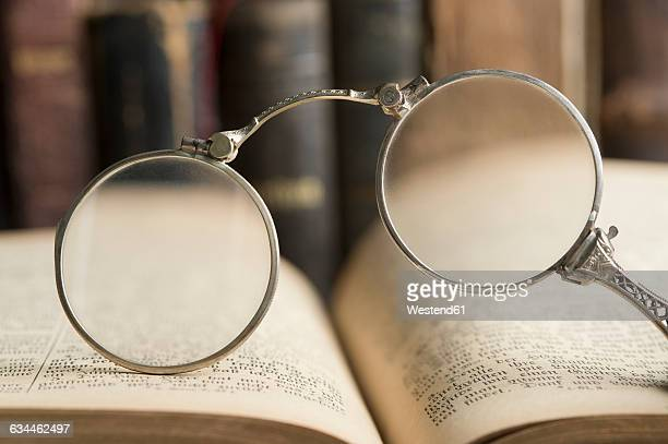 Lorgnette in front of antique books