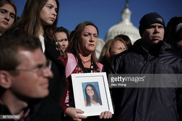 Lori Alhadeff and her husband Ilan Alhadeff hold a picture of their daughter Alyssa Alhadeff a Marjory Stoneman Douglas High School shooting victim...