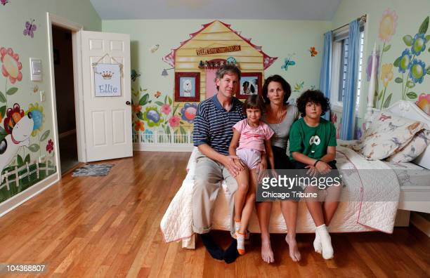 Lori and Craig Gertz of Long Grove Illinois pose with their children Jonah and Talia in the bedroom of daughter Ellie on August 25 2010 in Long Grove...