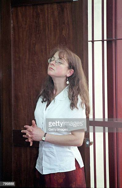 Lori Berenson the 31yearold New Yorker convicted of treason in Peru in 1996 stands near a prison courtroom wall April 9 2001 in San Juan de...