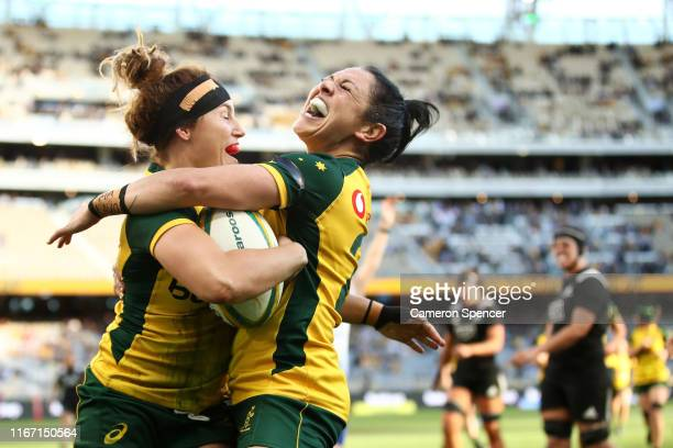 Lori Cramer of the Wallaroos celebrates scoring a try with Iliseva Batibasaga of the Wallaroos during the Women's Test Match between the Australian...