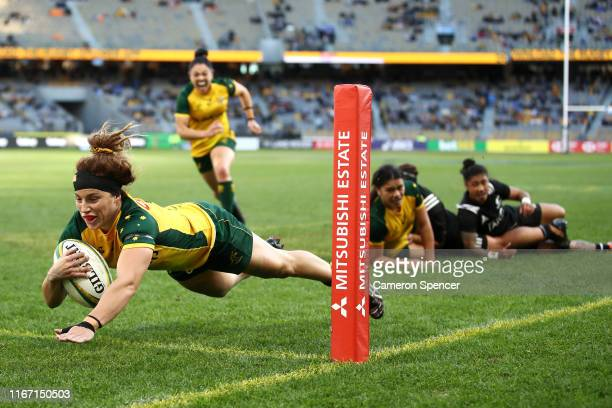 Lori Cramer of the Wallaroos scores a try during the Women's Test Match between the Australian Wallaroos and the New Zealand Black Ferns at Optus...
