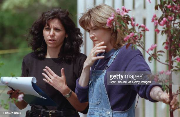 Lori Fink left producer goes over materials with Rebecca Kolls during the tapeing of her garden show