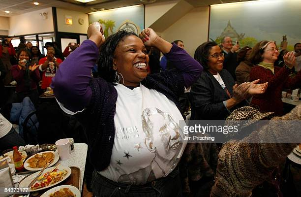 Lori Gordon jumps for joy as she listens to Barack Obama being sworn in as the 44th president of the United States at Valois Cafeteria purported to...