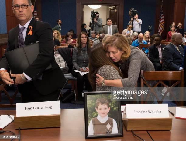 Lori Haas the mother of a survivor of the Virginia Tech shooting hugs Francine Wheeler mother of Ben Wheeler who was killed in the Sandy Hook...