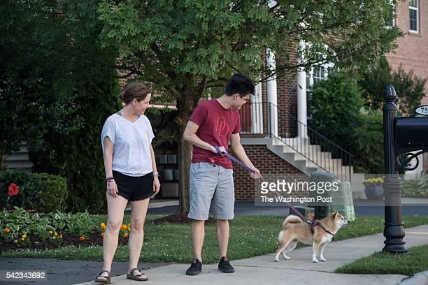 Lori Han 49 walks her dog Zoe with Jonah Han 18 along Lindberg Drive at The Grove at Huntley Meadows on June 18 2016 in Alexandria Virginia