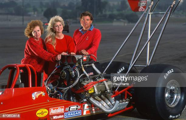 Lori Johns with her mother and father she doesn't just travel in the fast lane she lives in it Johns' forte is driving a Top Fuel dragster a machine...