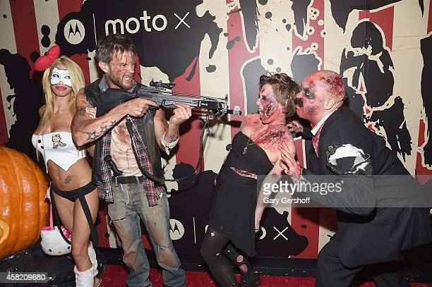 Lori Levine and Jamie McCarthy attend 'Heidi Klum's 15th Annual Halloween Party' at TAO Downtown on October 31 2014 in New York City