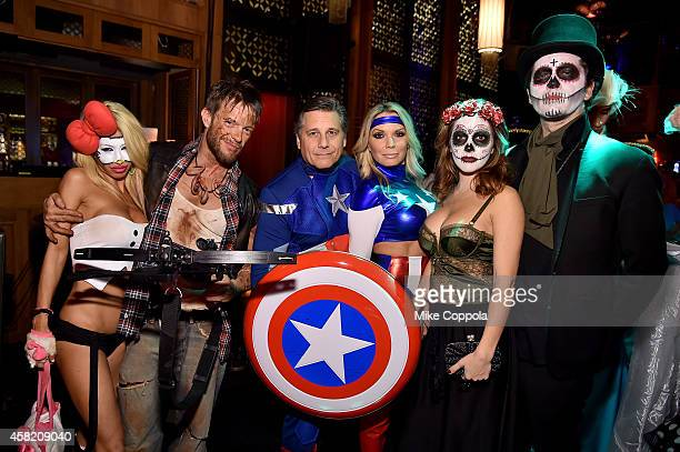 Lori Levine Jamie McCarthy Kevin Mazur Jennifer Mazur Melissa Stover and Theo Wargo attend Moto X presents Heidi Klum's 15th Annual Halloween Party...