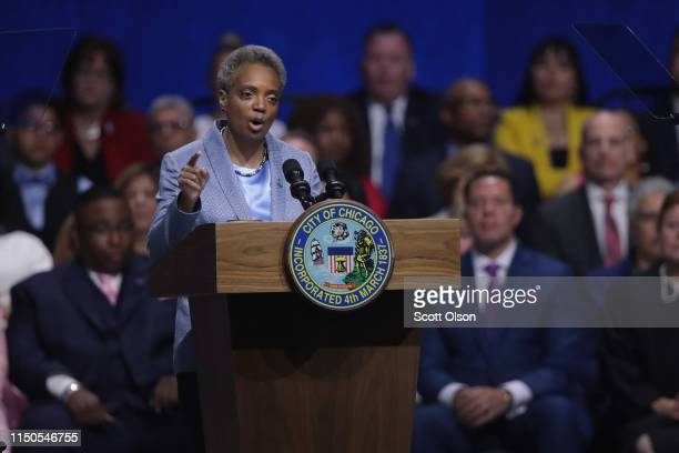 Lori Lightfoot addresses guests after being sworn in as Mayor of Chicago during a ceremony at the Wintrust Arena on May 20 2019 in Chicago Illinois...