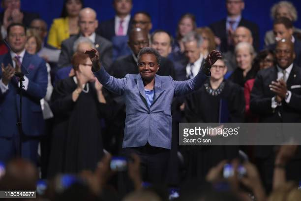 Lori Lightfoot celebrates after being sworn in as Mayor of Chicago during a ceremony at the Wintrust Arena on May 20 2019 in Chicago Illinois...
