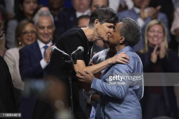 Lori Lightfoot is congratulated by her wife Amy Eshleman after being sworn in as Mayor of Chicago during a ceremony at the Wintrust Arena on May 20,...