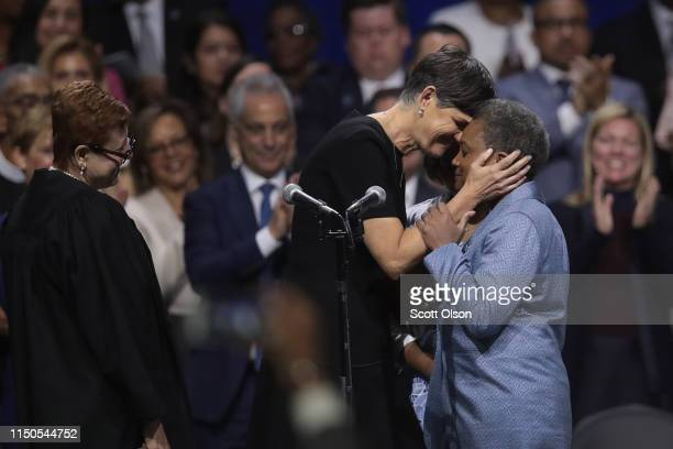Lori Lightfoot is congratulated by her wife Amy Eshleman after being sworn in as Mayor of Chicago during a ceremony at the Wintrust Arena on May 20...