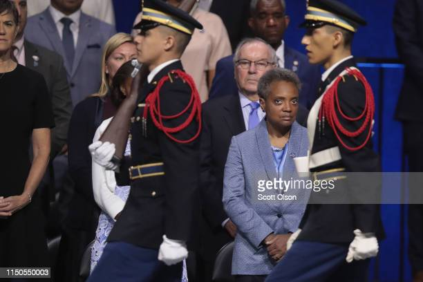 Lori Lightfoot watches the presentation of colors at her inauguration ceremony at the Wintrust Arena on May 20 2019 in Chicago Illinois Lightfoot...