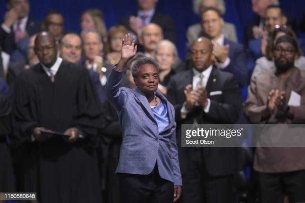 Lori Lightfoot waves to the crowd after being sworn in as Mayor of Chicago during a ceremony at the Wintrust Arena on May 20 2019 in Chicago Illinois...
