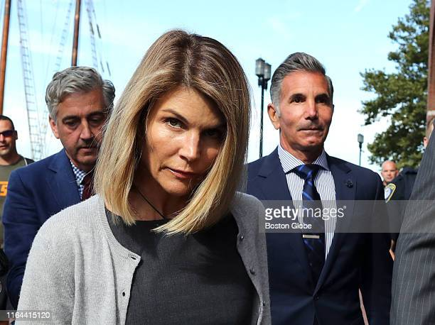 Lori Loughlin and her husband Mossimo Giannulli right leave the John Joseph Moakley United States Courthouse in Boston on Aug 27 2019 A judge says...