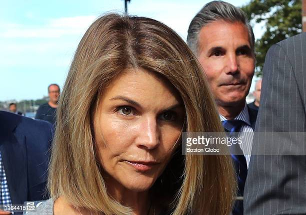 Lori Loughlin and her husband Mossimo Giannulli, right, leave the John Joseph Moakley United States Courthouse in Boston on Aug. 27, 2019. A judge...