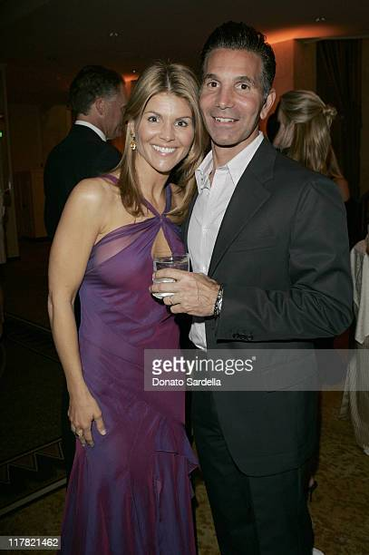 Lori Loughlin and Mossimo during Saks Fifth Avenue's Unforgettable Evening Benefitting EIF's Women's Cancer Research Fund at Regent Beverly Wilshire...