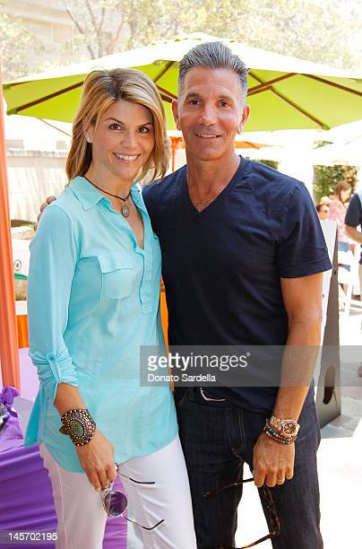 Lori Loughlin and Mossimo Giannulli attend 6th Annual Kidstock Music And Arts Festival Sponsored By Hudson Jeans at Greystone Mansion on June 3 2012...