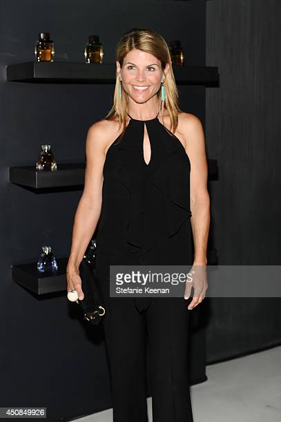 Lori Loughlin attends Vanity Fair And Vera Wang Celebrate The Opening Of Vera Wang On Rodeo Drive on June 18 2014 in Beverly Hills California