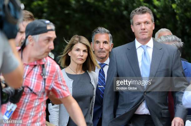 Lori Loughlin center left and her husband Mossimo Giannulli center right leave the John Joseph Moakley United States Courthouse in Boston on Aug 27...