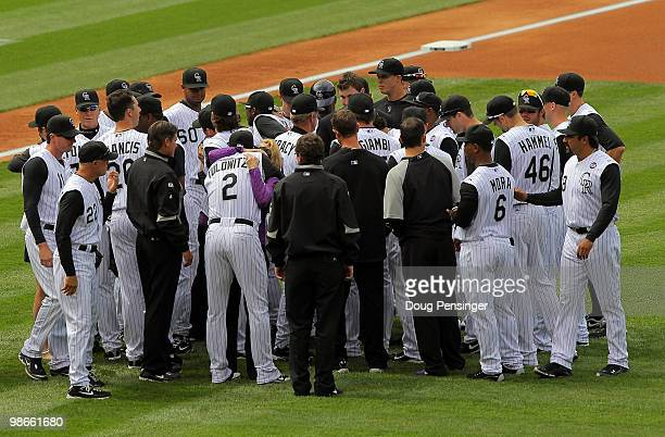 Lori McGregor and her four children are greeted by the Colorado Rockies players after a moment of silence in honor of her husband Keli McGregor...