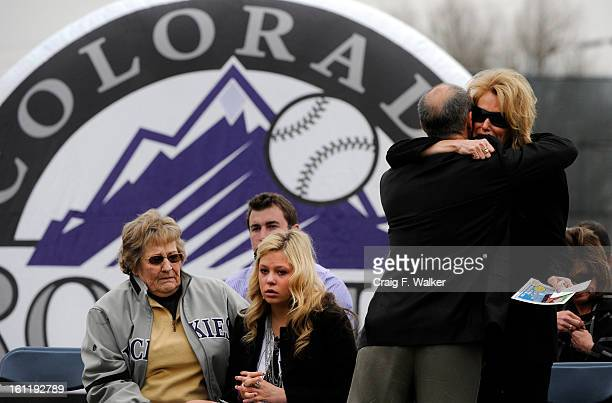 Lori McGregor right greets a friend at the beginning of a ceremony honoring her husband Keli McGregor where Keli McGregor Field was dedicated at...