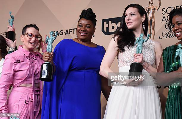 Lori Petty, Adrienne C. Moore, Laura Prepon, and Uzo Aduba, winners of the Outstanding Performance by an Ensemble in a Comedy Series Award, pose in...