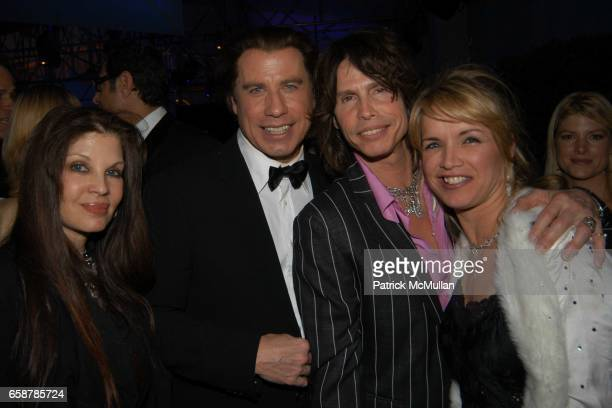 Lori Rodkin John Travolta Steven Tyler and Teresa Barrick attend the 2004 Vanity Fair Oscar Party at Mortons on February 29 2004 in Beverly Hills...