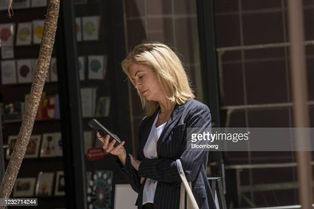Lori Wright, vice president of Xbox business development at Microsoft Corp., looks at a smartphone in front of the U.S. District court in Oakland,...