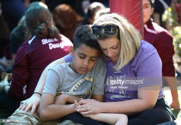 Loriell Chludinsky hugs her son 11 year old Kaiden Vaughn during a prayer vigil for famlies of Marjory Stoneman Douglas High School where a mass...
