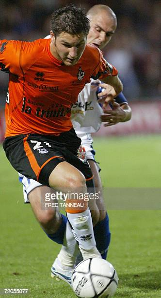Lorient's forward AndrePierre Gignac fights for the ball with Troyes' midfielder Benjamin Nivet during their French L1 football match 30 September...