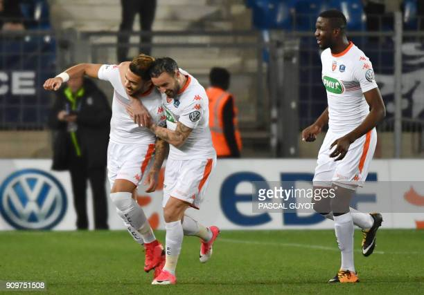 Lorient players react after scoring a goal during the French Cup round of 16 football match Montpellier vs Lorient at the La Mosson stadium in...