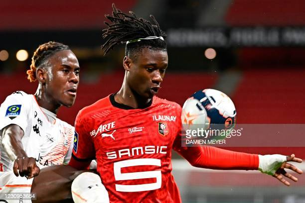 Lorient's British defender Trevoh Chalobah challenges Rennes' French midfielder Eduardo Camavinga during the French L1 football match between Stade...