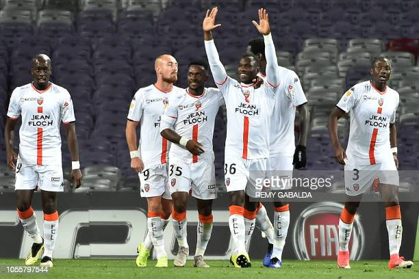 Lorient's Bukina Faso's forward Abdoul Sakirou Bila celebrates with teammates after scoring a goal during the French league cup football match...