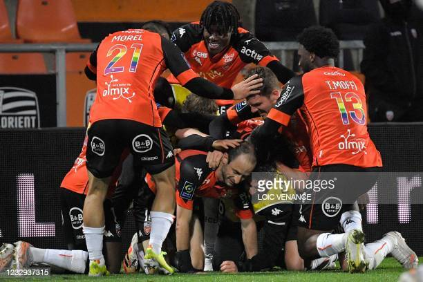 Lorient's French defender Jerome Hergault celebrates with teammates after scoring a goal during the French L1 football match between FC Lorient and...