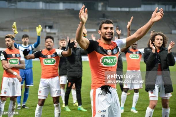 Lorient's French defender Lindsay Rose celebrates with his teammates after winning the French Cup football match match between Angers and Lorient ,...