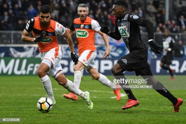 Lorient's French defender Lindsay Rose vies with Angers' Cameroonian forward Karl Toko Ekambi during the French Cup football match match between...