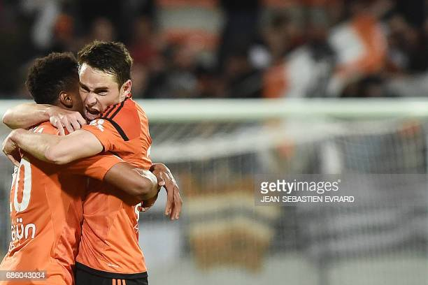 Lorient's French defender Vincent Le Goff celebrates with a teammate after scoring a goal during the French L1 football match between Lorient and...
