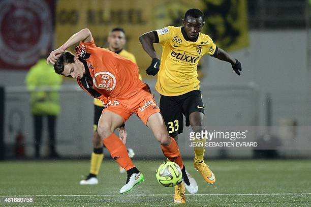 Lorient's French forward Benjamin Jeannot vies with Lille's Spanish midfielder Adama Traore during the French L1 football match Lorient vs Lille on...