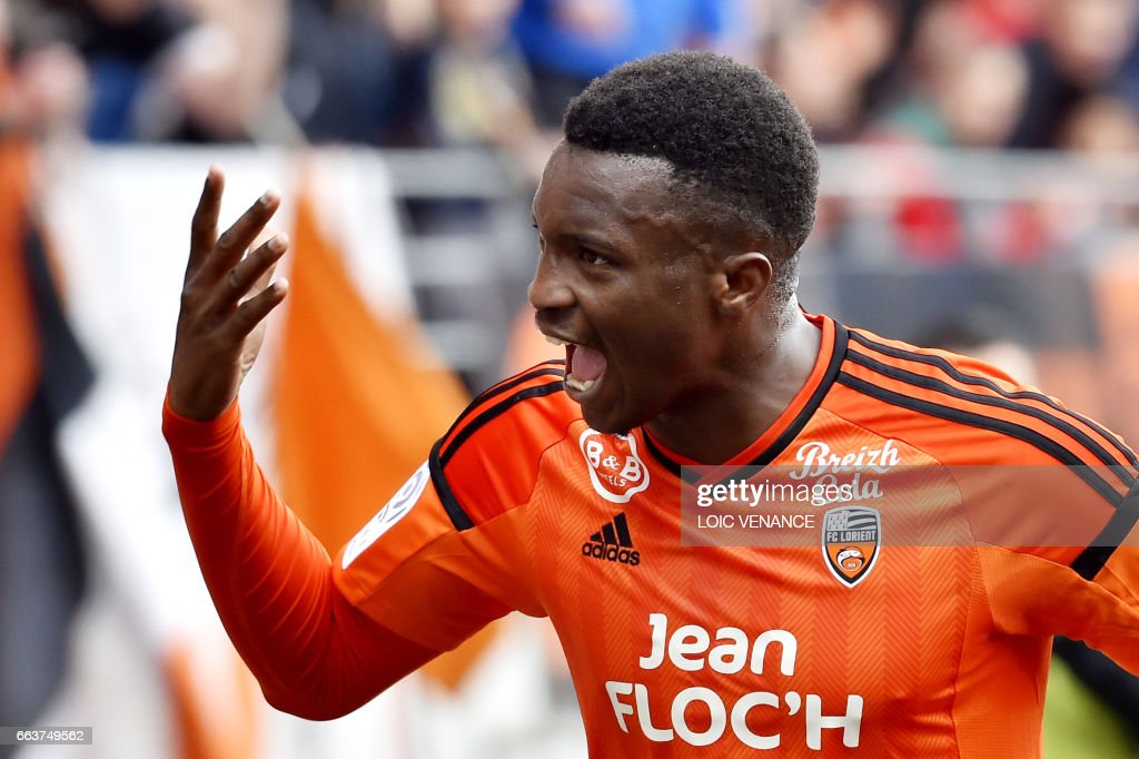 Lorient's French forward Benjamin Moukandjo celebrates after scoring during the French L1 football match between Lorient and Caen at Moustoir Stadium in Lorient on April 2, 2017. /