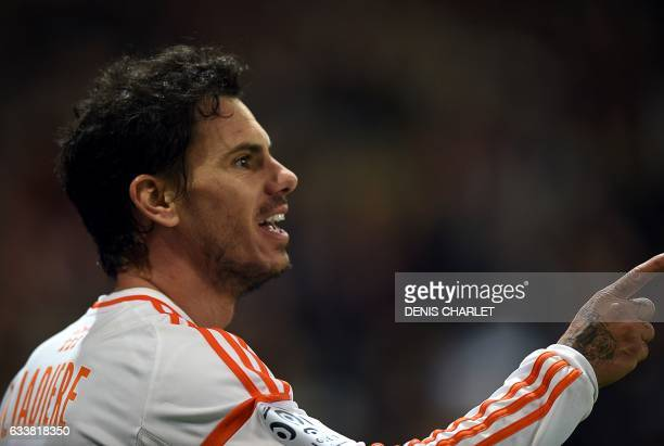 Lorient's French forward Jeremie Aliadiere celebrates after scoring a goal during the French Ligue 1 football match between Lille OSC and Lorient at...