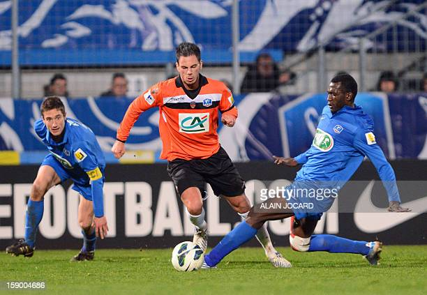 Lorient's French forward Jeremy Aliadiere vies with Chauvay's French midfielder Madi Aboubacar during the French cup football match Chauray vs...