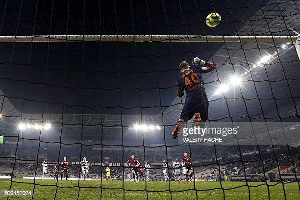 TOPSHOT Lorient's French goalkeeper Benjamin Lecomte makes a save during the French L1 football match Nice vs Lorient on January 23 2016 at the...