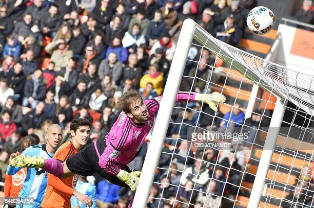 Lorient's French goalkeeper Benjamin Lecomte saves a goal during the French L1 football match FC Lorient vs Olympique de Marseille at the Moustoir...