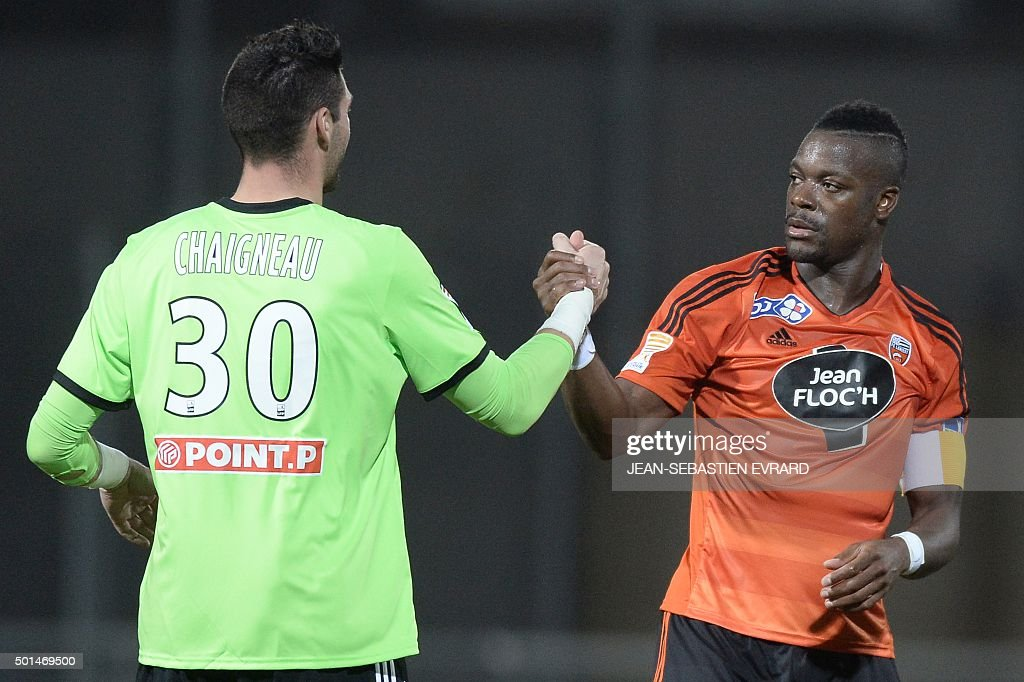 Lorient's French goalkeeper Florent Chaigneau (L) and Lorient's French Ivorian defender Lamine Kone celebrate at the end of the French League Cup football match between Lorient and Dijon on December 15, 2015 at the Moustoir stadium in Lorient, western France.