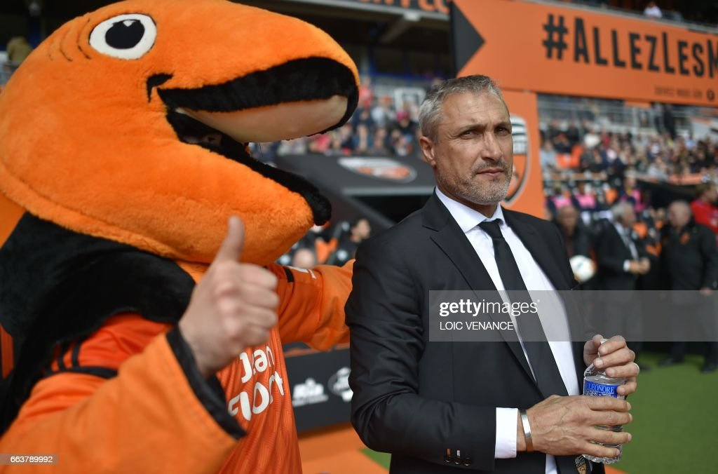 Lorient's French head coach Bernard Casoni waits for the beginning of the French L1 football match Lorient vs Caen at the Moustoir stadium in Lorient, western France, on April 2, 2017. /