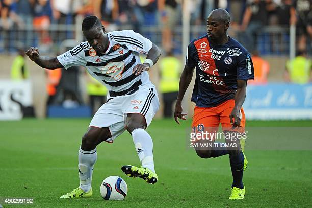 Lorient's French Ivorian defender Lamine Kone vies with Montpellier's Senegalese forward Souleymane Camara during the French Ligue 1 football match...